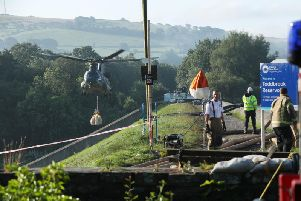 RAF Chinook drafted in at Todbrook Reservoir, Derbyshire, after Whaley Bridge residents evacuate their homes following heavy rainfall