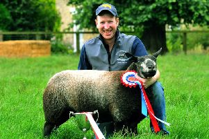 Mark Stephenson with his prizewinning Blue Texel Ewe Lamb at Nuburnholme Wold farm