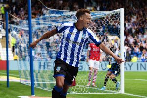 Debut delight: Jacob Murphy celebrates his early strike on his first Owls appearance. Pictures: Steve Ellis