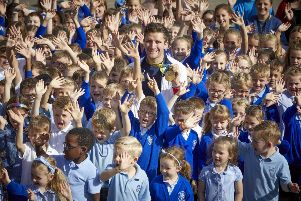 ALDI Rothwell near Leeds in Yorkshire grand opening.' with Olympic gold medal cyclist Callum Skinner and Rothwell Primary pupils