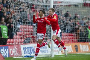 Right on cue: Callum Styles, right, pictured celebrating with Jacob Brown, is hoping to claim a first-team place. (Picture: Scott Merrylees)