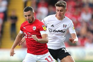 Fulham's Tom Cairney (right) and Barnsley's Conor Chaplin (left) battle for the ball.