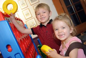 Mansfield Museum are holding Toys, Games and Puzzles 'Erin Aspinall, 2 and her 5 year old brother Josh have a go on the giant oxo game in Mansfield Museum on Monday.