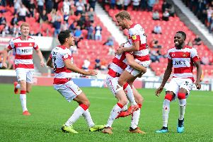 James Coppinger celebrates with team mates as Rovers find the winning goal in stoppage time against Fleetwood Town