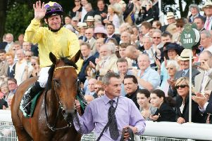 Salute: Sea The Stars and Mick Kinane return to the winner's enclosure after victory in the 2019 Juddmonte International at York.