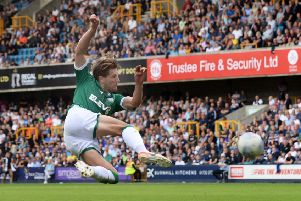 Going close: Sam Hutchinson lets fly.