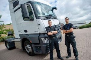 PC Dave Lee and PC Rob Monk from Northamptonshire Police's Safer Roads Team with one of the HGV supercabs. Picture courtesy of Northamptonshire Police.