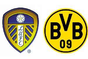 Leeds United and Borussia Dortmund club badges.