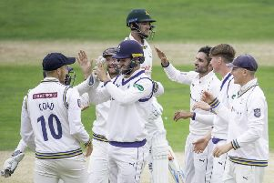 Yorkshire's Keshav Maharaj celebrates the wicket of Nottinghamshire's Joe Clarke.