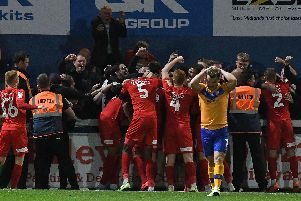 Orient celebrate their winner.