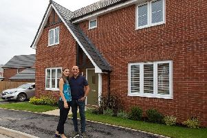 Hannah and Ian outside their new home; Ian proposed to Hannah on the day they got their keys