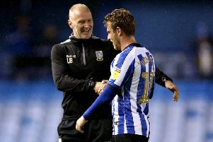 Well done: Sheffield Wednesday caretaker manager Lee Bullen  speaks to Sam Winnall at the end of the Championship match at Hillsborough.