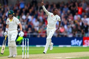 DANGER MAN: England's Jofra Archer (centre) celebrates taking the wicket of Australia's Marcus Harris on day one at Headingley. Picture: Mike Egerton/PA