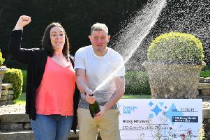 Vicky Mitchell, from Halifax, celebrates her National Lottery win with her partner Adam at the Holdsworth Hotel in Halifax. Picture by Anthony Devlin.