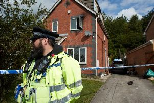 Police at the scene of the fire