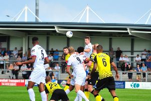 Neill Byrne gets a header in but Fylde's creative play is a worry for their manager Dave Challinor   Picture: STEVE MCLELLAN