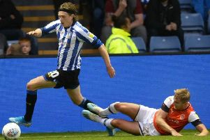Sheffield Wednesday winger Adam Reach is pictured taking on Luton Town's James Bree in the Owls' 1-0 earlier this month. (Picture: Steve Ellis)