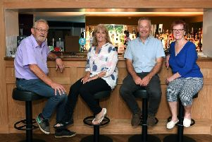 The White Horse pub in Church Fenton has been reopened by the community, who have raised the money to buy it. Pictured are Church Fenton Community Hub members from left, Mike Wright, Lesley Wright, Nigel Thirkill and Sue Babington. Picture by Jonathan Gawthorpe.