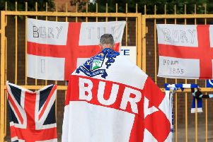 End of the line: A Bury fan at the gates of Gigg Lane.