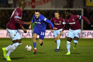 ONE TO WATCH: Dylan Connolly takes on West Ham United in last season's famous FA Cup victory over the Premier League club for AFC Wimbledon. Picture: Ben Stansall/Getty Images)