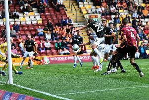 LUCKY STRIKE: Northampton's Michael Harriman puts the ball in his own net to make it 1-1.' Picture: Jonathan Gawthorpe.