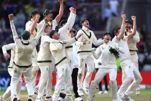 Australia celebrate after they claimed victory to retain the Ashes at Old Trafford.