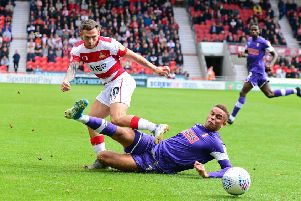 Doncaster's Jon Taylor and Rotherham's Carlton Morris, pictured. Picture: Marie Caley