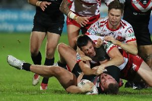 Hull KR's Joel Tomkins on top of London Broncos' Rob Butler during a number of feisty flashpoints in Friday's game. (PIC: Allan McKenzie/SWpix.com)