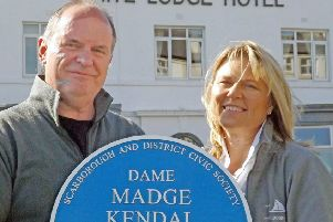 James and Kim Hodgson with the plaque