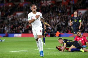 England's Jadon Sancho celebrates scoring his side's fourth goal.