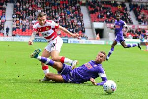 Doncaster Rovers' Jon Taylor battles against his former club, Rotherham last weekend, pictured. Picture: Marie Caley