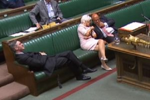 Leader of the House of Commons Jacob Rees-Mogg reclining on his seat in the House of Commons.