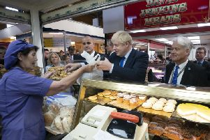 British Prime Minister Boris Johnson shops at a bakery during a visit to Doncaster Market. Photo: Jon Super - WPA Pool/Getty Images