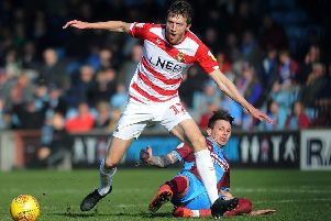 NO WAY THROUGH: Doncaster Rovers' Tom Anderson takes on Scunthorpe's Adam Hammill. Picture: Jonathan Gawthorpe