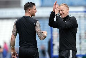 Well done: Manager Garry Monk with goalkeeper Keiren Westwood. Picture: Steve Ellis
